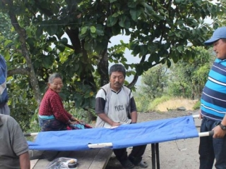 Health Co-ordinator with patient and stretcher